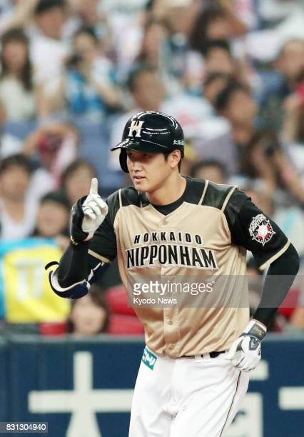 Shohei Otani rounds the bases after hitting a solo home run in the ninth inning of the Nippon Ham Fighters' 71 win over the SoftBank Hawks at Kyocera...