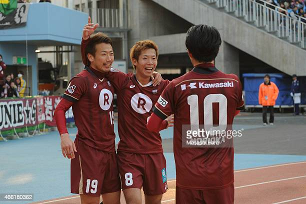Shohei Takahashi and Kazuma Watanabe of Vissel Kobe celebrate the second goal during the JLeague match between Kawasaki Frontale and Vissel Kobe at...