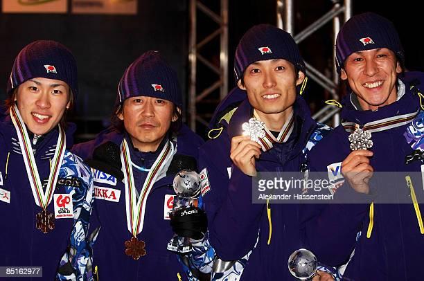 Shohei Tochimoto, Takanobu Okabe, Daiki Ito and Noriaki Kasai of Japan pose with the Bronze medals won during the Men's Team Ski Jumping 134M Hill...