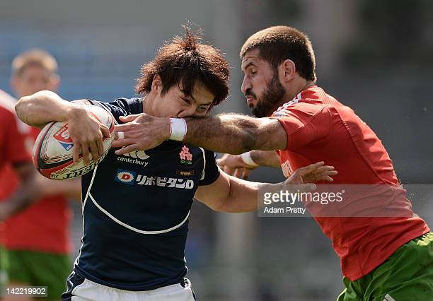 Shohei Toyoshima of Japan is tackled by of Goncalo Foro Portugal in the Japan vs Portugal match during day two of the Tokyo Sevens at Prince Chichibu...