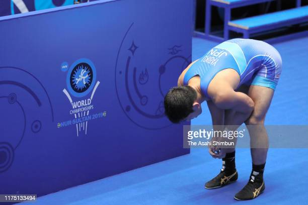 Shohei Yabiku of Japan shows dejection after his defeat by Karapet Chalyan of Armenia in the Men's 77kg second round on day three of the World...