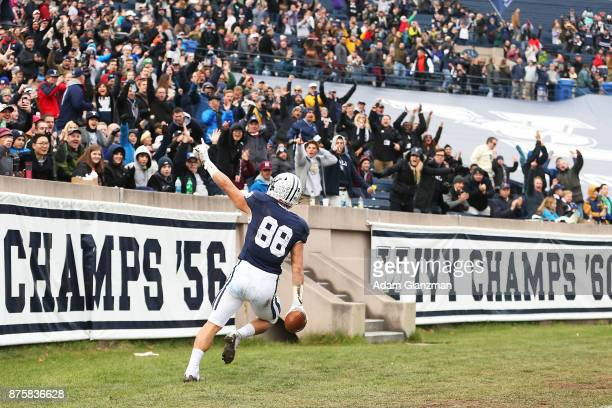 Shohfi of the Yale Bulldogs reacts after scoring a touchdown in the first half of a game against the Harvard Crimson at the Yale Bowl on November 18...