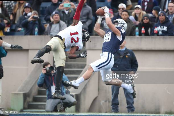 Shohfi of Yale scores a touchdown as he receives a pass from quarterback Kurt Rawlings in the end zone while defended by Isaiah Wingfield of Harvard...