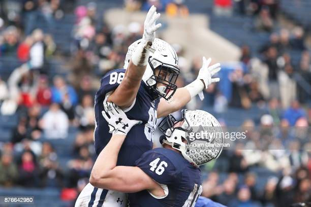 Shohfi reacts with Jaeden Graham of the Yale Bulldogs after scoring a touchdown in the first half of a game against the Harvard Crimson at the Yale...