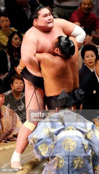 Shohozan pushes Mongolian ozeki Terunofuji out of the ring to win during day five of the Grand Sumo Autumn Tournament at Ryogoku Kokugikan on...