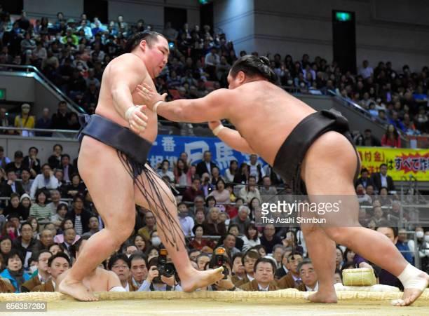 Shohozan pushes Mongolian yokozuna Kakuryu out of the ring to win during day six of the Grand Sumo Spring Tournament at Edion Arena Osaka on March 17...