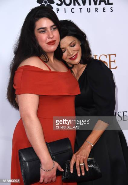 Shohreh Aghdashloo and daughter Tara Touzie attend the premiere of 'The Promise' at the Chinese theatre in Hollywood on April 12 2017 / AFP PHOTO /...