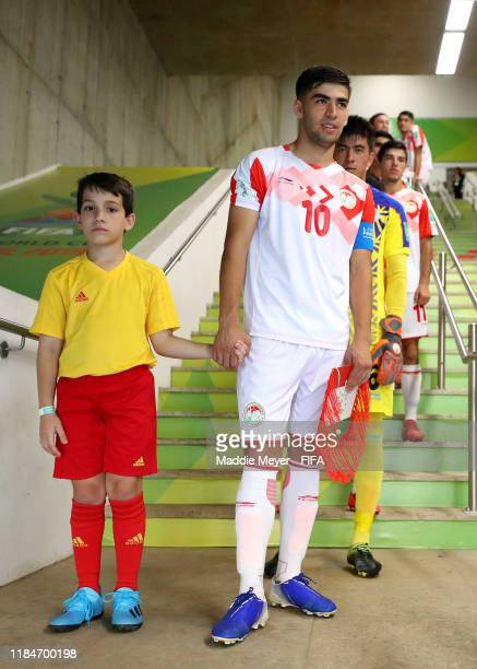 Shohrukh Qirghizboev of Tajikistan stands in the tunnel with a player escort before the FIFA U17 World Cup Brazil 2019 group E match between Spain...