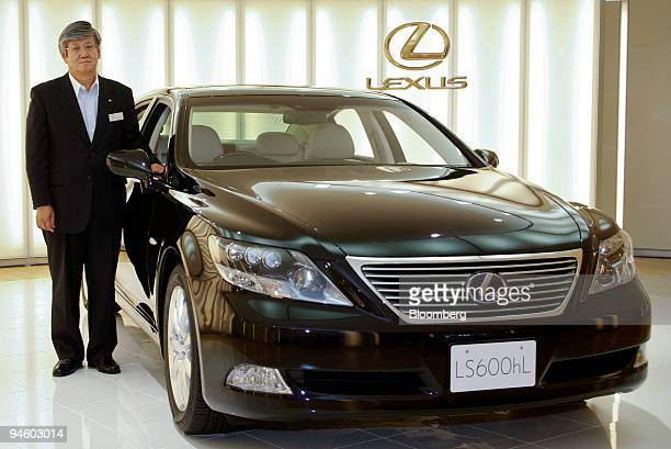 Shoji Ikawa senior managing director in charge of production engineering group of Toyota Motor Corp poses with a Lexus LS600 at the Tahara plant...