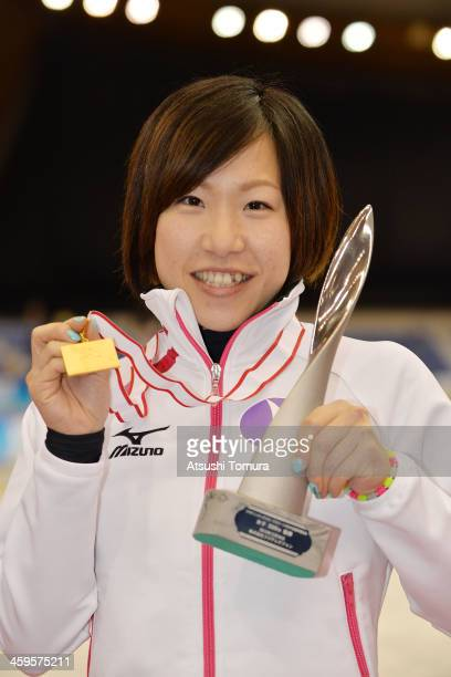 Shoko Fujimura of Japan poses with her gold medal in the women's 3000m victory ceremony during Japan Speed Skating Olympic Qualifying Championships...
