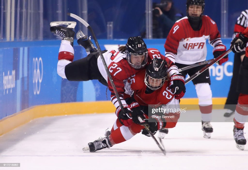 Shoko Ono #27 of Japan falls on top of Dominique Ruegg #26 of Switzerland in the second period during the Women's Ice Hockey Preliminary Round - Group B game on day three of the PyeongChang 2018 Winter Olympic Games at Kwandong Hockey Centre on February 12, 2018 in Gangneung, South Korea.