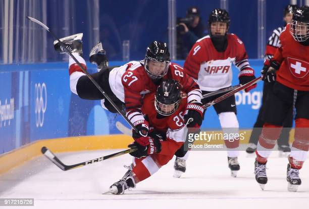 Shoko Ono of Japan falls on top of Dominique Ruegg of Switzerland in the second period during the Women's Ice Hockey Preliminary Round - Group B game...