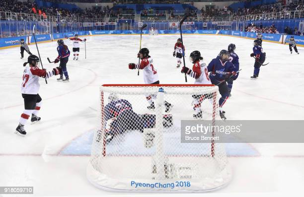 Shoko Ono of Japan Miho Shishiuchi of Japan and Akane Hosoyamada of Japan celebrate after a goal against Korea in the first period during the Women's...