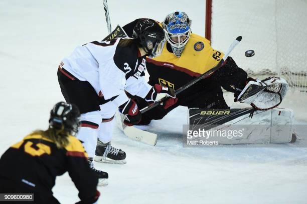 Shoko Ono of Japan scores a goal against goalkeeper Franziska Albl of Germany during the Women's Ice Hockey International Friendly match between...