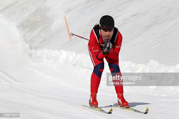 Shoko Ota of Japan competes in the Women's Standing 10km Individual Cross Country during day one of the Winter Games NZ at Snow Farm on August 13...