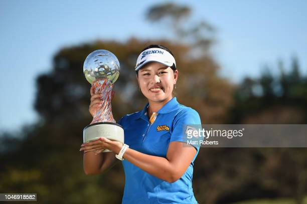 Shoko Sasaki of Japan poses during the trophy presentation after winning the Stanley Ladies at Tomei Country Club on October 7, 2018 in Susono,...