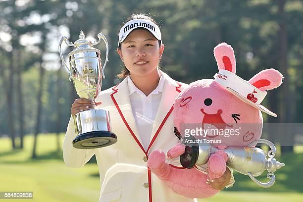 Shoko Sasaki of Japan poses with the trophy after winning the Daito Kentaku Eheyanet Ladies 2016 at the Narusawa Golf Club on July 31 2016 in...