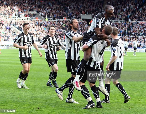 Shola Ameobi celebrates on top of Kevin Nolan after Nolan scored the opening goal during the Barclays Premier League match between Newcastle United...