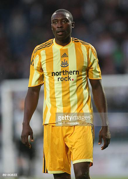 Shola Ameobi in action during a preseason friendly match between Huddersfield Town and Newcastle United at the Galpharm Stadium on July 21 2009 in...