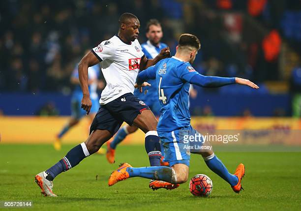 Shola Ameobi of Bolton Wanderers and Will Evans of Eastleigh compete for the ball during the Emirates FA Cup Third Round Replay match between Bolton...
