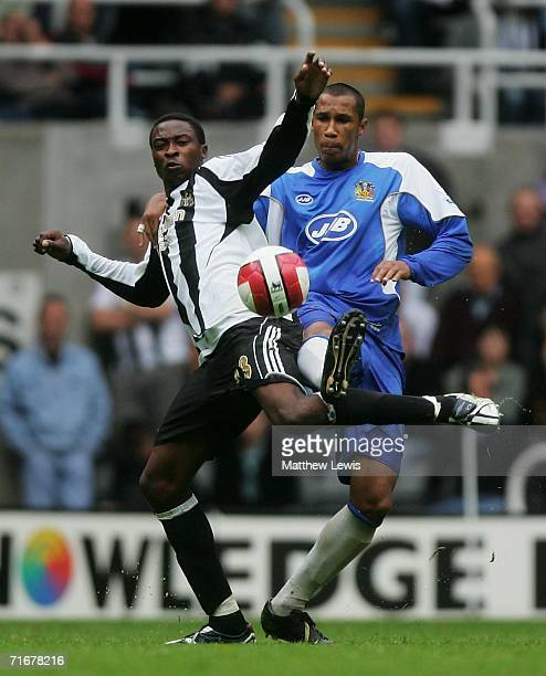 Shola Ameobi of Newcastle and Fitz Hall of Wigan challenge for the ball during the Barclays Premiership match between Newcastle United and Wigan...
