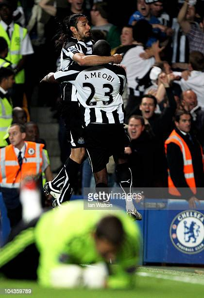 Shola Ameobi of Newcastle celebrates with teammate Jonas Gutierrez after scoring his team's fourth goal during the Carling Cup third round match...