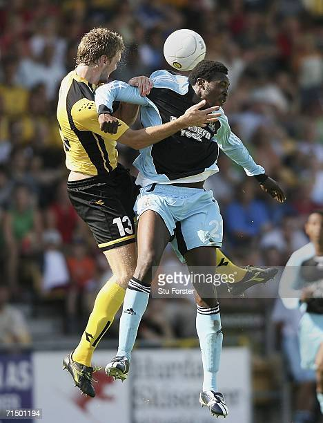 Shola Ameobi of Newcastle goes up for a header with Frode Kippe of Lillestrom SK during the second leg of the Intertoto Cup between Lillestrom SK and...