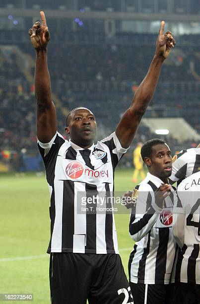 Shola Ameobi of Newcastle United celebrates after scoring from the penalty spot during the UEFA Europa League round of 32 second leg match between FC...