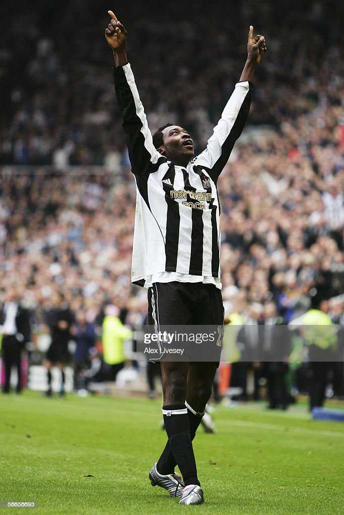 Shola Ameobi of Newcastle United celebrates his first goal with team mates during the Barclays Premiership match between Newcastle United and Sunderland at St James' Park on October 23, 2005 in Newcastle, England.