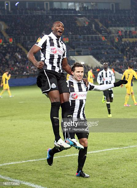 Shola Ameobi of Newcastle United celebrates with Yohan Cabaye after scoring from the penalty spot during the UEFA Europa League round of 32 second...