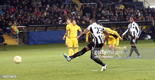 Shola Ameobi of Newcastle United scores from the penalty spot during the UEFA Europa League round of 32 second leg match between FC Metalist Kharkiv...