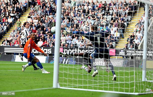 Shola Ameobi of Newcastle United scores the 20 goal past Reading's goalkeeper Adam Federici during the CocaCola Championship match between Newcastle...