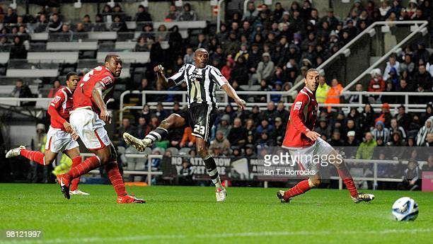 Shola Ameobi of Newcastle United scores the opening goal during the Coca Cola Championship match between Newcastle United and Nottingham Forest at St...