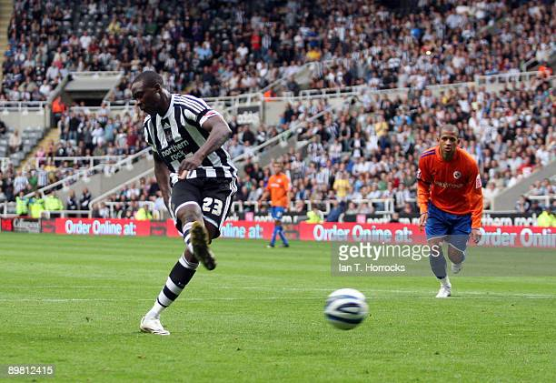 Shola Ameobi of Newcastle United shoots to score the 30 goal from the penalty spot during the CocaCola Championship match between Newcastle United...