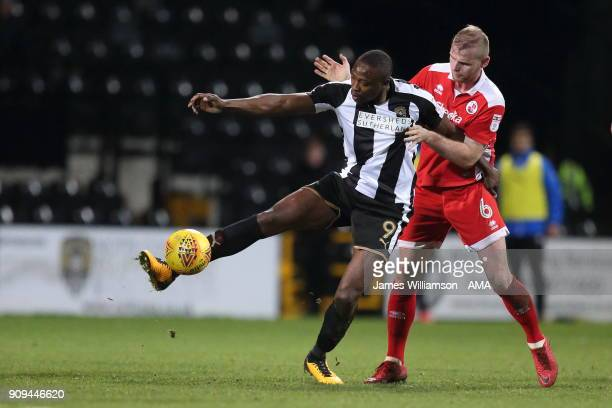 Shola Ameobi of Notts County and Mark Connolly of Crawley Town during the Sky Bet League Two match between Notts County and Crawley Town at Meadow...