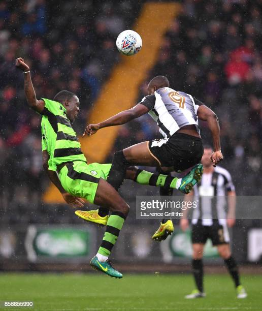 Shola Ameobi of Notts County battles with Isaiah Osbourne of Forest Green Rovers during the Sky Bet League Two match between Notts County and Forest...