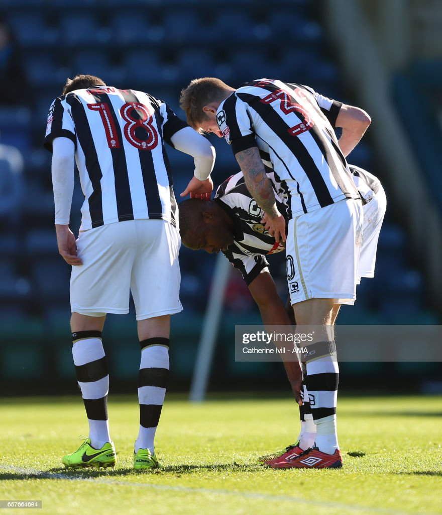 Shola Ameobi of Notts County is congratulated by his team mates after he scores to make it 0-1 during the Sky Bet League Two match between Wycombe Wanderers and Notts County at Adams Park on March 25, 2017 in High Wycombe, England.