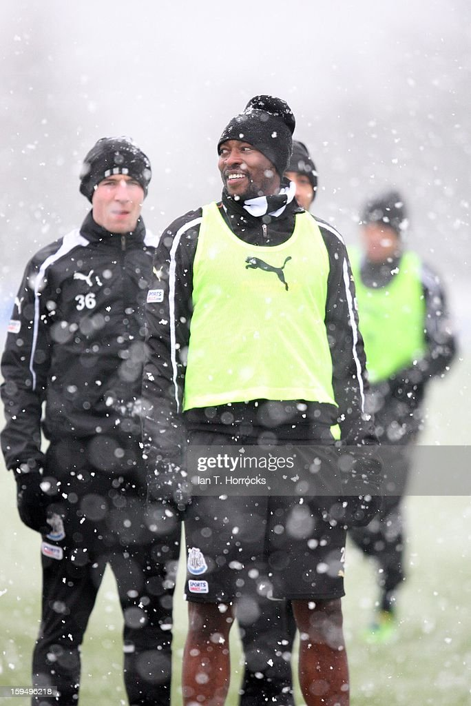 Shola Ameobi smiles in the snow during a Newcastle United training session at the Little Benton Training Ground on January 14, 2013 in Newcastle upon Tyne, England.