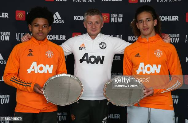 Shola Shoretire and Hannibal Mejbri of Manchester United are presented with the Jimmy Murphy Young Player of the Year award and the Denzil Haroun...
