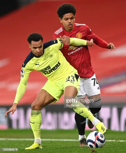 Shola Shoretire of Manchester United challeges Jacob Murphy of Newcastle during the Premier League match between Manchester United and Newcastle...