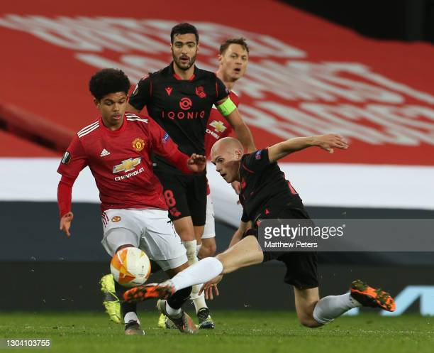 Shola Shoretire of Manchester United in action with Jon Guridi of Real Sociedad during the UEFA Europa League Round of 32 match between Manchester...