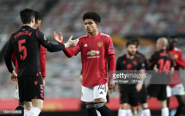 Shola Shoretire of Manchester United interacts with Igor Zubeldia of Real Sociedad during the UEFA Europa League Round of 32 match between Manchester...