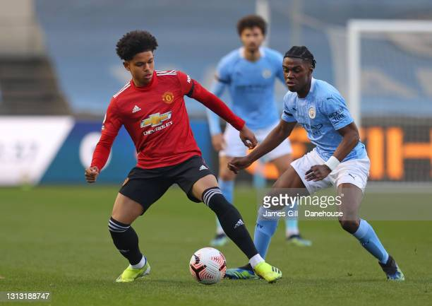 Shola Shoretire of Manchester United is challenged by Romeo Lavia of Manchester City during the Premier League 2 match between Manchester City and...