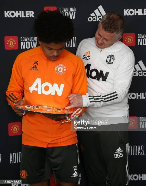 Shola Shoretire of Manchester United is presented with the Jimmy Murphy Young Player of the Year award by Manager Ole Gunnar Solskjaer at Aon...