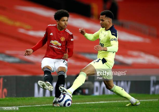Shola Shoretire of Manchester United makes a pass whilst under pressure from Jacob Murphy of Newcastle United during the Premier League match between...
