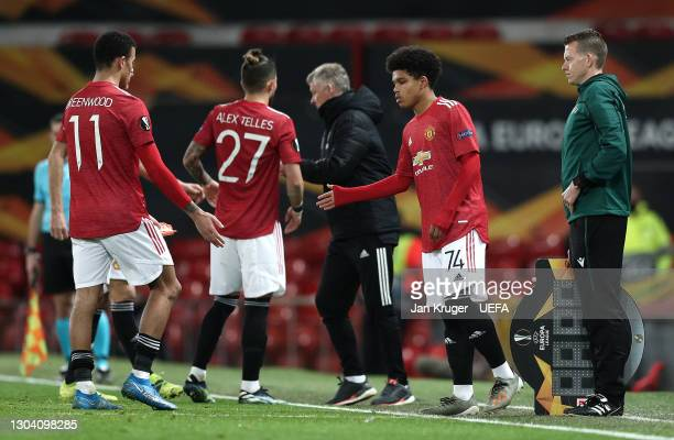 Shola Shoretire of Manchester United shakes hands with Mason Greenwood of Manchester United as he is substituted during the UEFA Europa League Round...