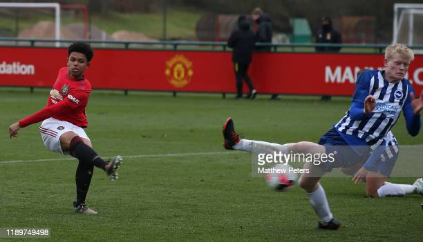 Shola Shoretire of Manchester United U18s scores their first goal during the U18 Premier League match between Manchester United U18s and Brighton and...