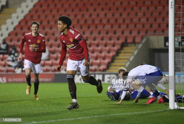 Shola Shoretire of Manchester United U23s celebrates scoring their fifth goal during the Premier League 2 match between Manchester United U23s and...
