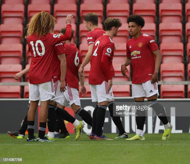 Shola Shoretire of Manchester United U23s celebrates scoring their second goall during the Premier League 2 match between Manchester United U23s and...