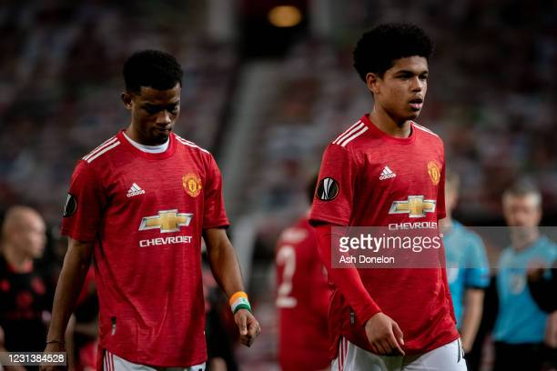 Shola Shoretire of Manchester United walks of with Amad at the end of the UEFA Europa League Round of 32 match between Manchester United and Real...